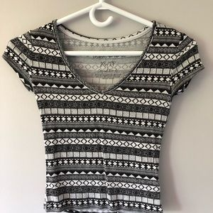 Black and white patterned t-shirt.
